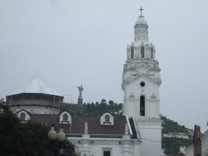 Statue of the Virgin of Quito above the church on the Plaza Grande