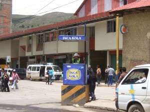 A friendly Inca Kola cop directing traffic